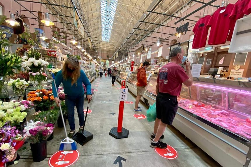 Shoppers observing safe distancing at Eastern Market in Washington DC, on May 17, 2020.