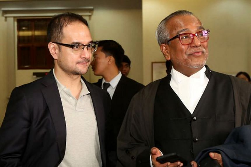 Mr Riza Aziz (far left) with his lawyer Tan Sri Muhammad Shafee Abdullah at the High Court in Kuala Lumpur after he was granted a discharge not amounting to an acquittal last Thursday. PHOTO: THE STAR/ASIA NEWS NETWORK
