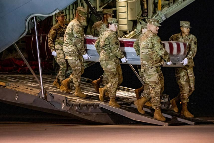 The coffin of one of the people killed in the attack at Naval Air Station Pensacola.