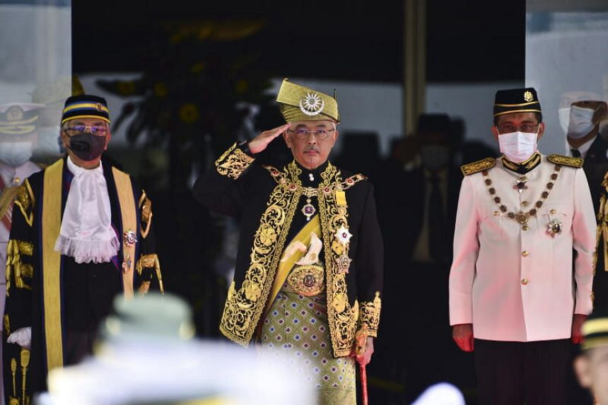 Malaysia's King Sultan Abdullah Ri'ayatuddin (centre) said he was responsible for appointing a new prime minister after Mr Mahathir Mohamad resigned.