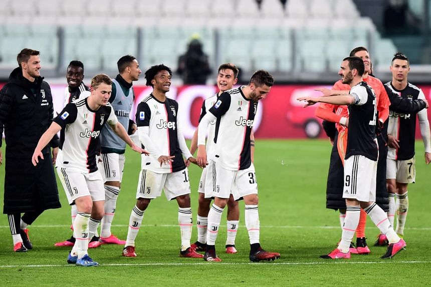 In a photo taken on March 8, 2020, Juventus players celebrate after the match.