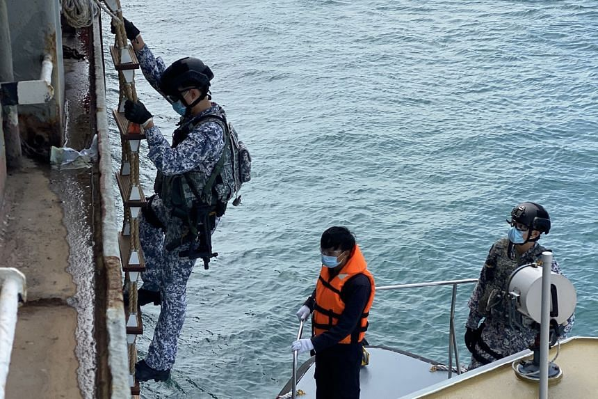 An Accompanying Sea Security Team operator climbing a Jacob's ladder during a recent boarding operation. Such operations involve checking ships for stowaways and suspicious goods and activities.