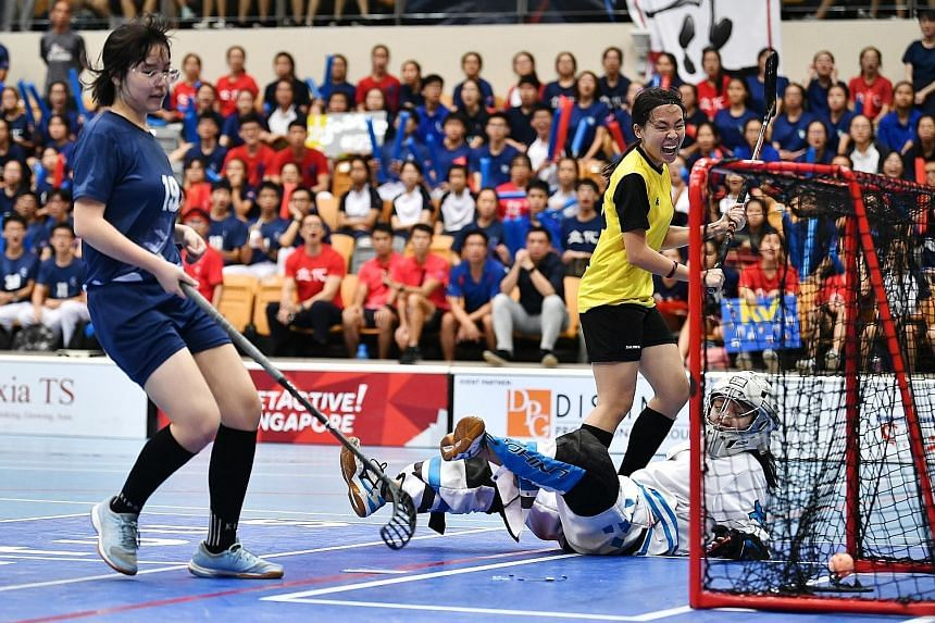 Chan Jing Xuan of Victoria Junior College scoring the first goal in the 1-1 draw with River Valley High School in the A Division floorball final last year. VJC, who won the penalty shoot-out 2-0, will not get to defend their title after the National