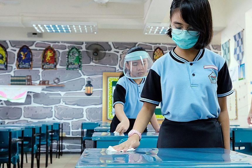 Schools must put in place hygiene practices when they reopen, such as having students wipe down surfaces before leaving the classroom.