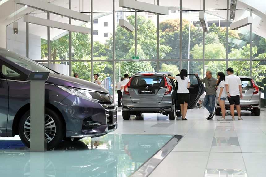 A photo from July 7, 2018, showing customers at the showroom of Honda agent Kah Motor in Alexandra Road.