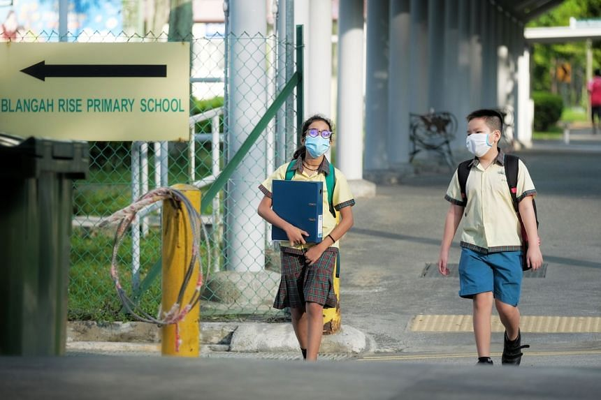 Pupils wearing masks as they return to Blangah Rise Primary School on May 19, 2020.