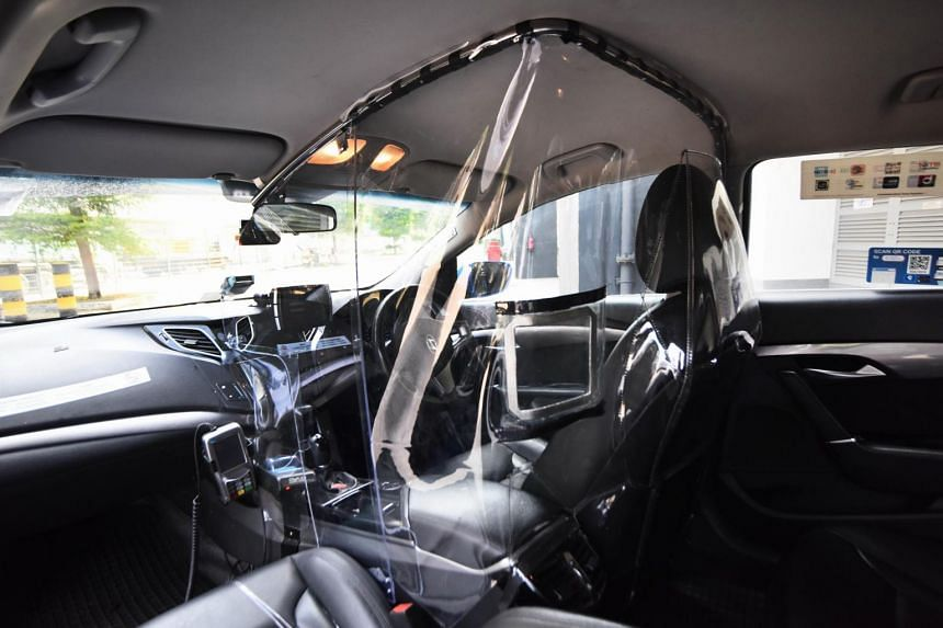 """Called V-shield, the locally manufactured shield covers the driver's cabin entirely and has two """"window"""" openings for passengers to make payment."""