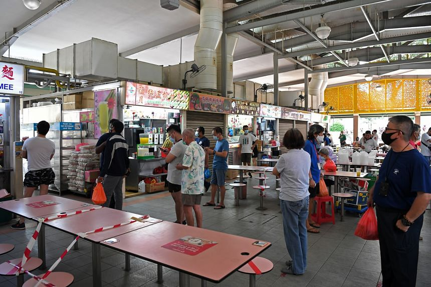 People queueing to order food at the Whampoa Hawker Centre, on May 18, 2020.