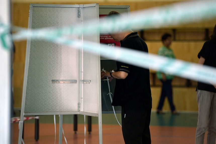 A voter in the hall of Pei Chun Public School on Sept 11, 2015.