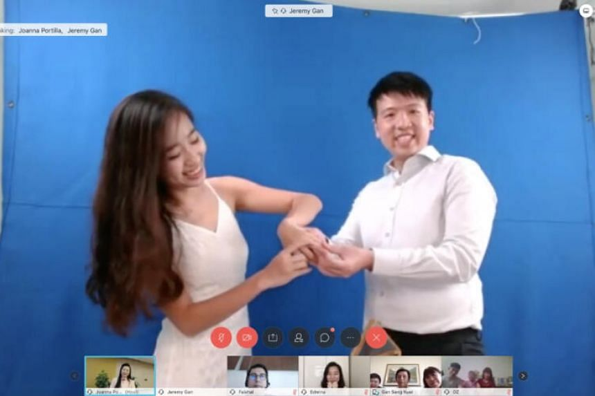 Ms Lim Ding Yi (left) and husband Jeremy Gan holds a solemnisation ceremony at their flat via video link.