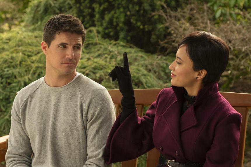 Still of Robbie Amell and Andy Allo (right) in Upload.