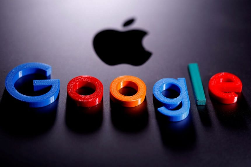 A 3D printed Google logo is placed on an Apple Macbook in this photo illustration.
