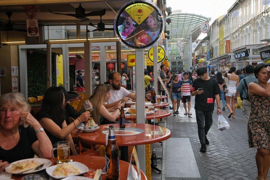 People at a restaurant along Pagoda Street on May 24, 2019.