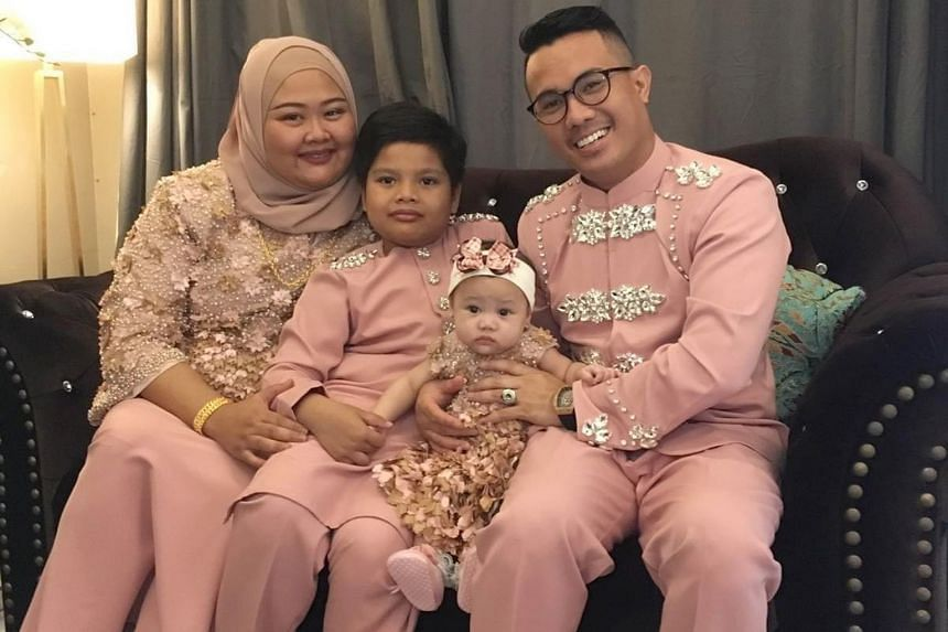 Ms Zuliza Zulkifli, who runs Nasi Ambeng Asli Jurong West, with her husband Mohd Shahrulnizam, a chef, and their children – nine-year-old Andyka and two-year-old Humairah. Ramadan bazaars, such as the one at Geylang Serai, have been cancelled this