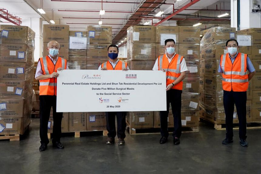 (From left)  Mr Pua Seck Guan, chief executive of Perennial, Mr Desmond Lee, Minister for Social and Family Development, Mr Steve Chu, project director of Shun Tak, and Mr Phillip Tan, chairman of Community Chest.