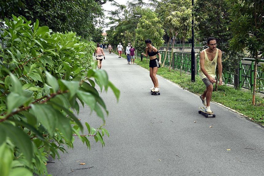 Left: Even after the circuit breaker period ends on June 1, people who need to exercise should do so in their immediate neighbourhood, such as at a park or park connector near them. Below: Apart from face masks, plastic face shields can be worn by st