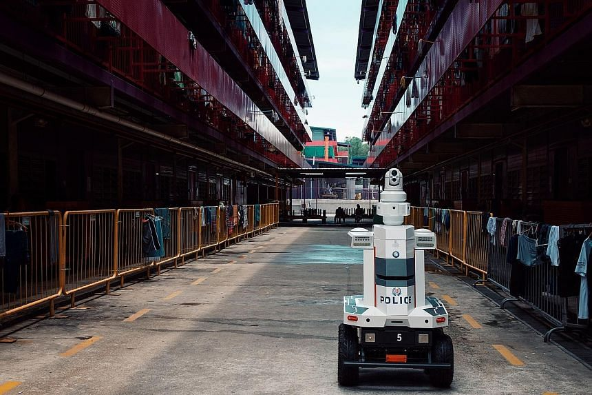 Two of the Multi-purpose All-Terrain Autonomous Robots, or Matar, are currently in a foreign workers' dormitory in the eastern part of Singapore. Equipped with cameras and speakers, they can patrol areas on their own, with an operator in a command ce