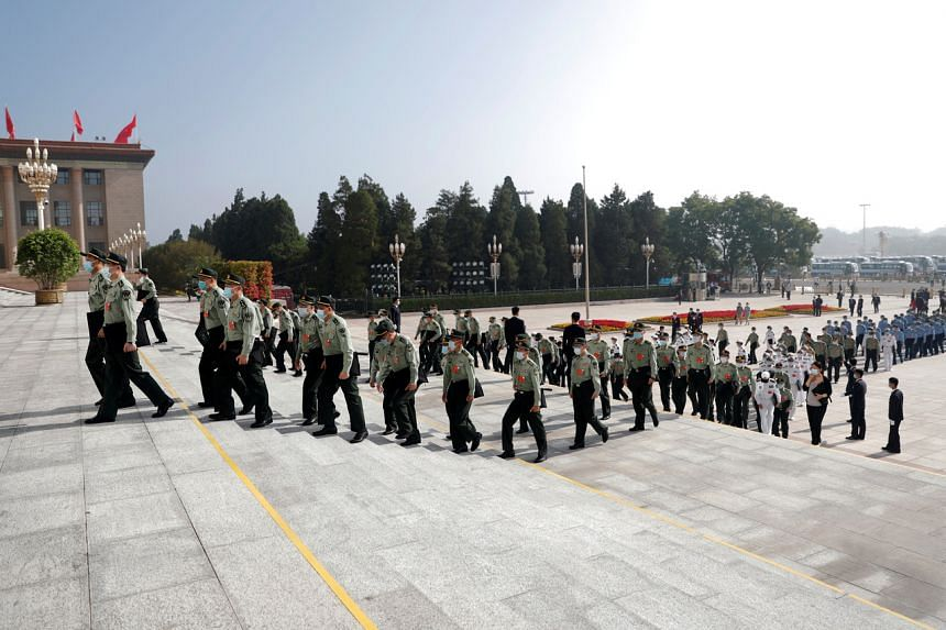 Military delegates arrive to the Great Hall of the People before the opening session of the National People's Congress on May 22, 2020.