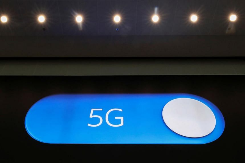 An advertising board shows a 5G logo at the International Airport in Zaventem, Belgium, on May 4, 2020.