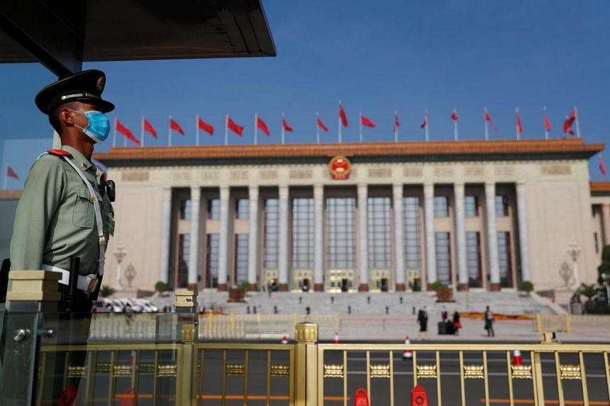 A paramilitary police officer stands guard outside the Great Hall of the People before the opening session of the National People's Congress on May 22, 2020.