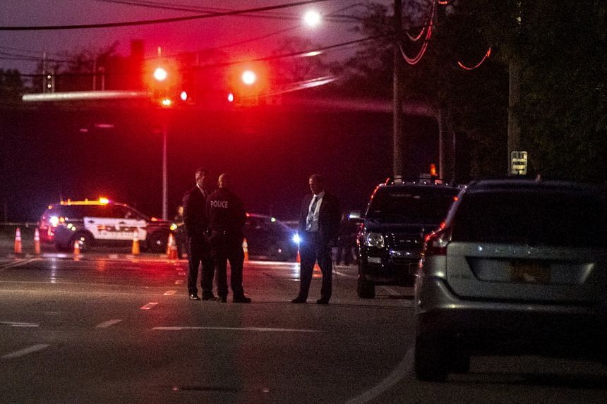 Police officers are seen outside the scene of a fatal stabbing in Amityville, New York, on May 21, 2020.