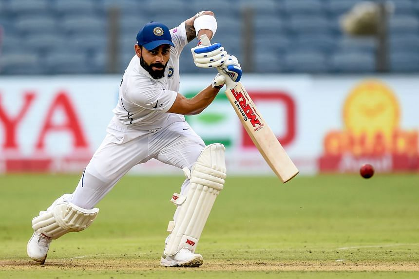 India's captain Virat Kohli plays a shot in Pune, India, on Oct 10, 2019.