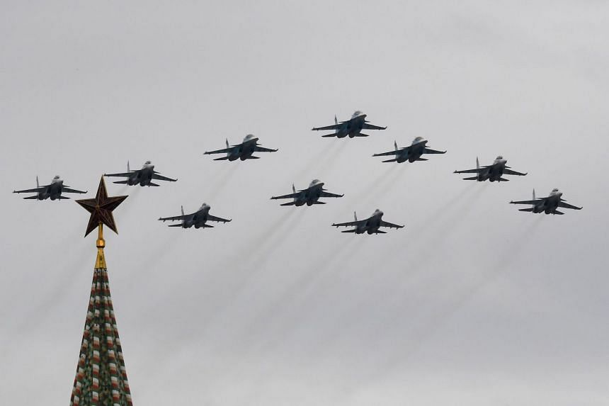 Russian fighter jets fly over the Kremlin and Red Square in Moscow to mark victory over Nazi Germany in World War II.