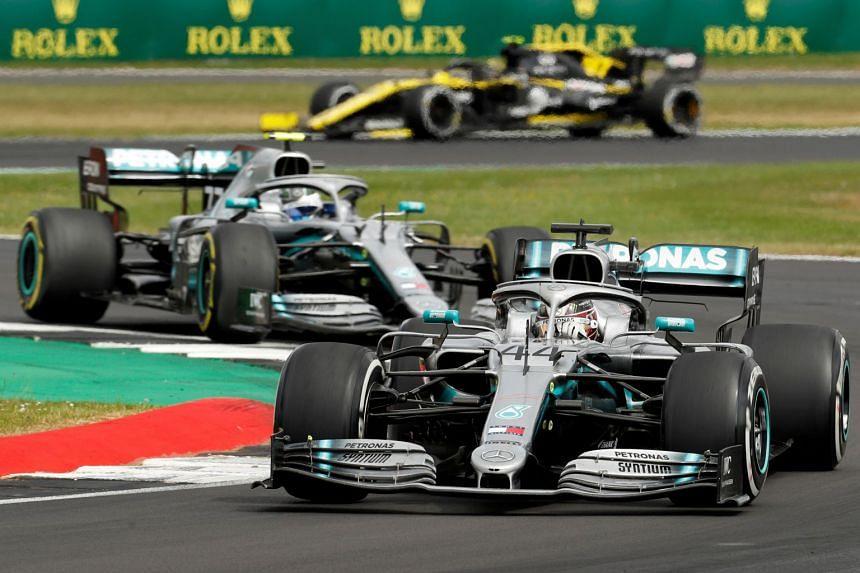 Mercedes' Lewis Hamilton and Mercedes' Valtteri Bottas in action during the 2019 British grand prix.