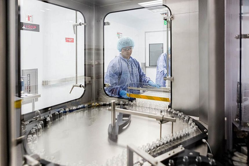 Above: Living cells in dry ice are shipped to biomedical firm Proteona for Covid-19 research.Right: Gilead Sciences is working with multiple manufacturing partners to boost the production and supply of its Covid-19 antiviral drug remdesivir. PHOTO: G