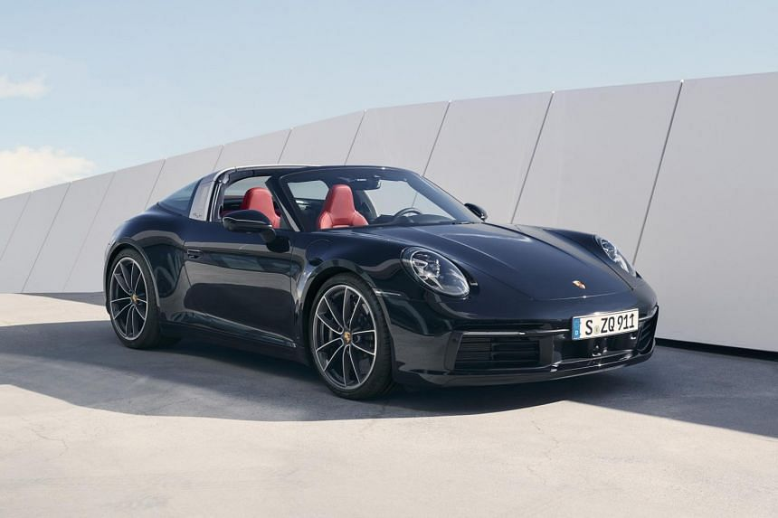 The all-wheel-drive Porsche Targa 4 and Targa 4S sport a fully automatic roof system and a wraparound rear window.