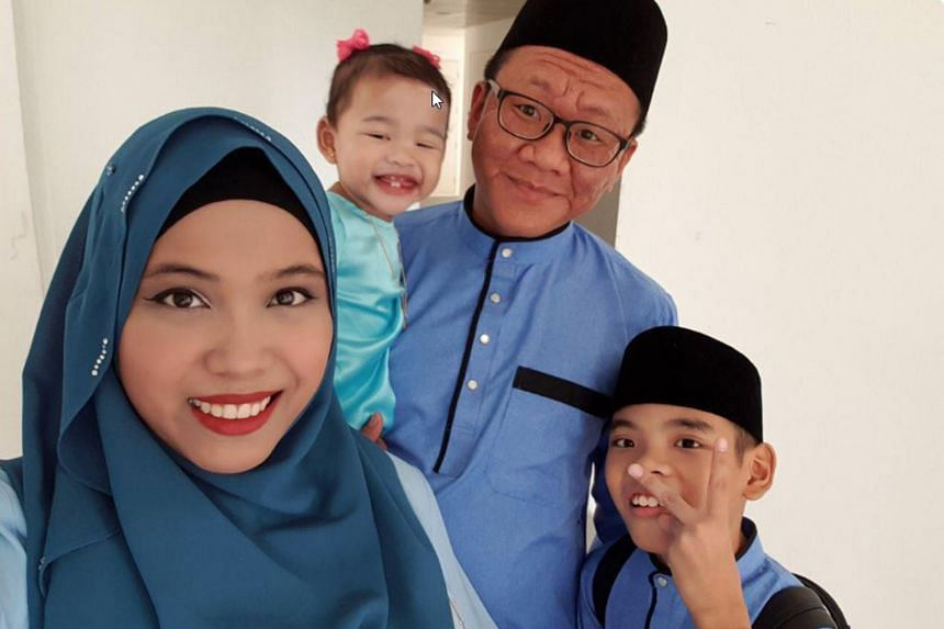 """Mr Muhammad Shalehan (above, with his wife and two of his three children) was backed by English singersongwriter Tony Hadley, who said the SMRT train captain had pronounced """"Hadley"""" correctly."""