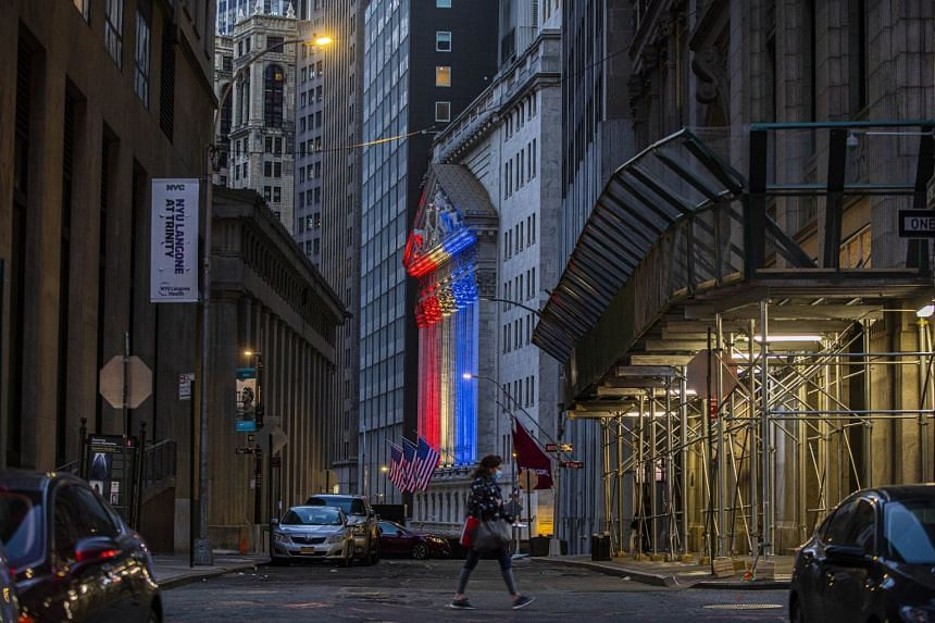 The New York Stock Exchange building is lit with red, white, and blue lights ahead of the Memorial Day holiday.