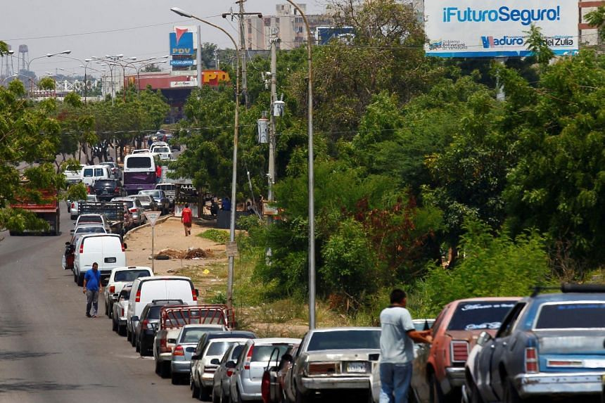 People with vehicles wait in line in an attempt to refuel at a gas station in Maracaibo, Venezuela, May 17, 2019.