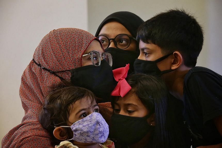 Madam Seha (not her real name) with her children (clockwise from top) - her 13-year-old daughter, 11-year-old son, six-year-old daughter and two-year-old daughter. She, her husband and children tested positive for the coronavirus and were all hospita