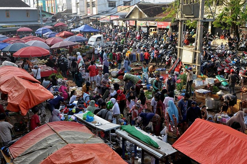 Huge crowds at a traditional market in Bandar Lapmpung, Lampung province, yesterday, ahead of Aidilfitri celebrations, in this photo taken by Antara Foto. Widespread social distancing violations have generated angry responses from social media users
