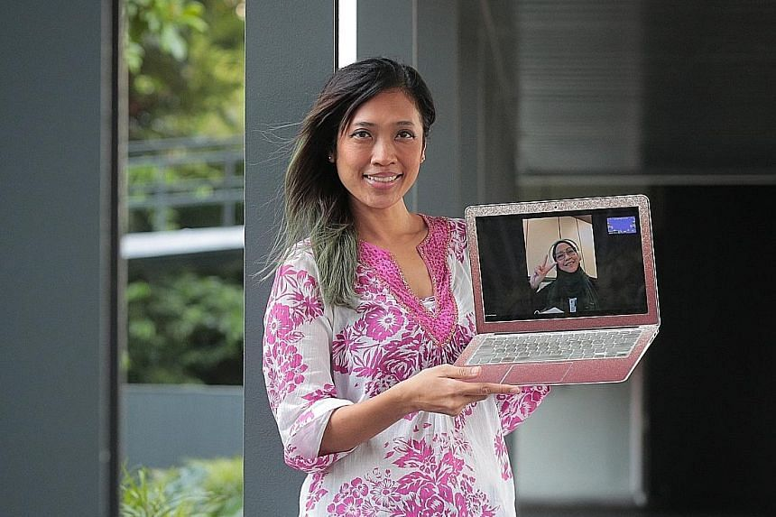 Ms Liana Rosnita Redwan-Beer on a Zoom call with her sister, Ms Lilies Roseita Redwan, last Thursday. Ms Liana aims to set up a Zoom call with her extended family to mark Hari Raya Aidilfitri electronically. ST PHOTO: JASON QUAH