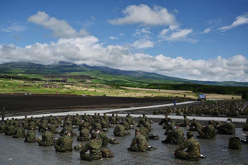 Soldiers from the Japan Ground Self-Defence Force taking part in a live-firing exercise at the Higashi-Fuji firing range in Gotemba, Shizuoka prefecture, yesterday. Despite the coronavirus outbreak, Japan's defence forces have continued to conduct mi