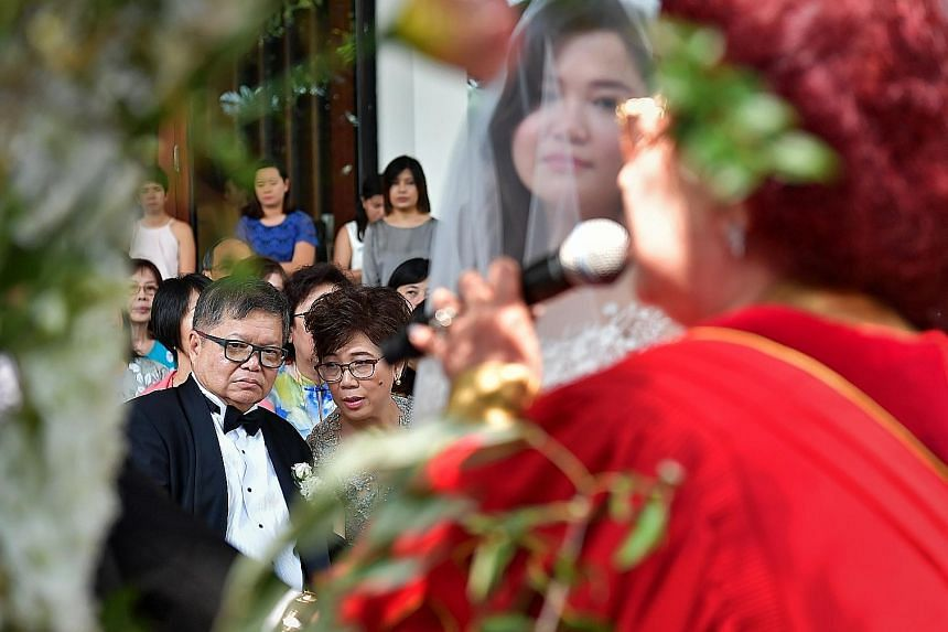Steven's eldest daughter Desiree, 36, throwing rice at her parents, sister Jessica and brother-in-law Brandon, 29, on Nov 9 last year.