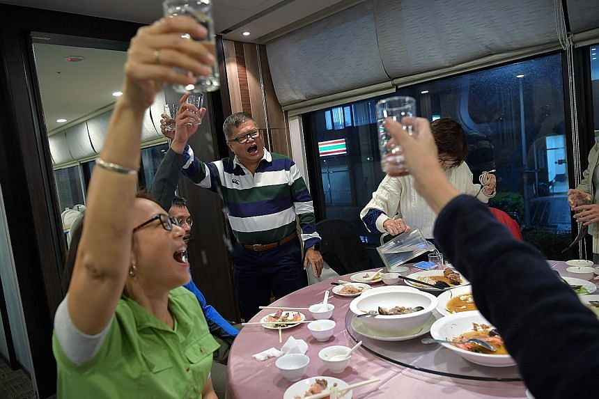 Steven and Lai Quen on a study trip to Taiwan last November, along with five others with dementia and their caregivers. The trip was organised by the Alzheimer's Disease Association and the Lien Foundation. Steven leading a toast at dinner during the