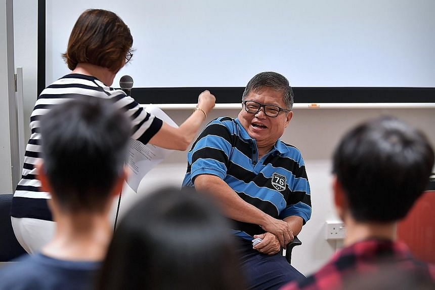 Lai Quen, during the couple's talk to NUS students last November, acting out an incident where Steven had punched her brother-in-law. Lai Quen in tears after Steven presented her with a bouquet of flowers after a sharing session at the National Libra
