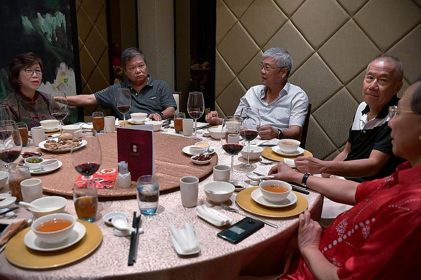 Steven's eldest daughter, Desiree, having dinner with her parents on Feb 7 while her daughters played in the background at Steven's home. Desiree tries to have dinner with her parents as often as she can. (From left) Ms Wong Lai Quen and her husband