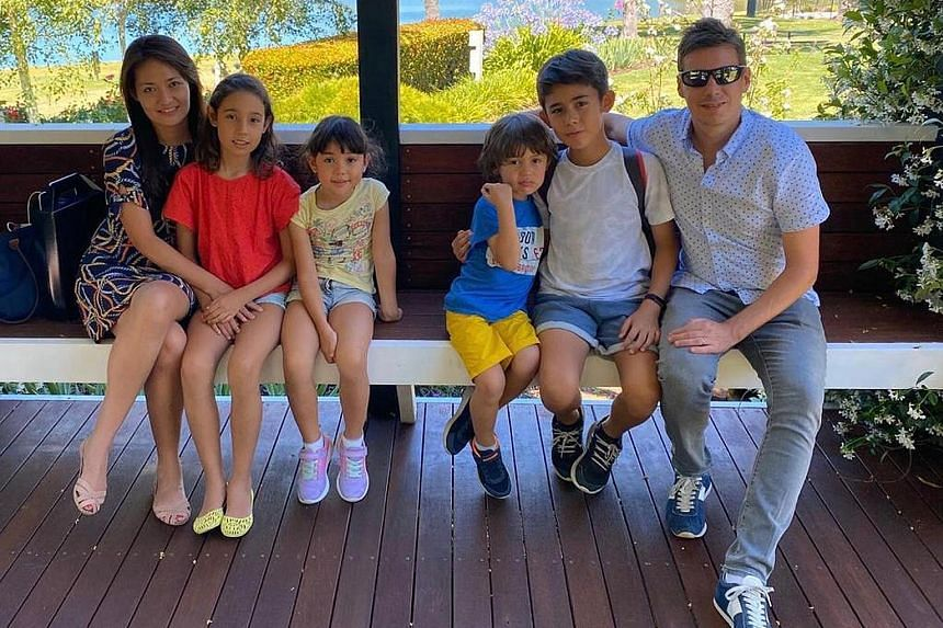 Ms Joyce Lim with her children – (from left) Kayla, 11, Ally, eight, Dylan, six, and Nathan, 13 – and her husband Thomas Ball, 43, a business development manager. The stay-at-home mum is looking forward to the staggering of school days for non-graduating