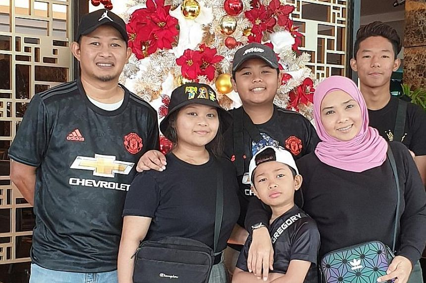 Ms Linda Othman is preparing her schoolgoing sons Ryqe (back row, centre), 15, and Ryle (front row, centre), 10, for school by readjusting their sleeping hours. With them are her husband Rahmat Ramli, 43, a technical specialist; daughter Rhea, 16, who is