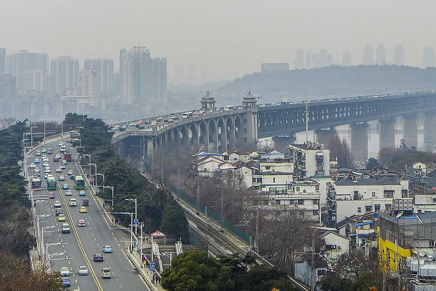 Completed in 1957, the Wuhan Yangtze River Bridge (above) was the first major bridge built over the Yangtze river. The lower level hosts a railway line and the upper deck has a highway and pedestrian paths.