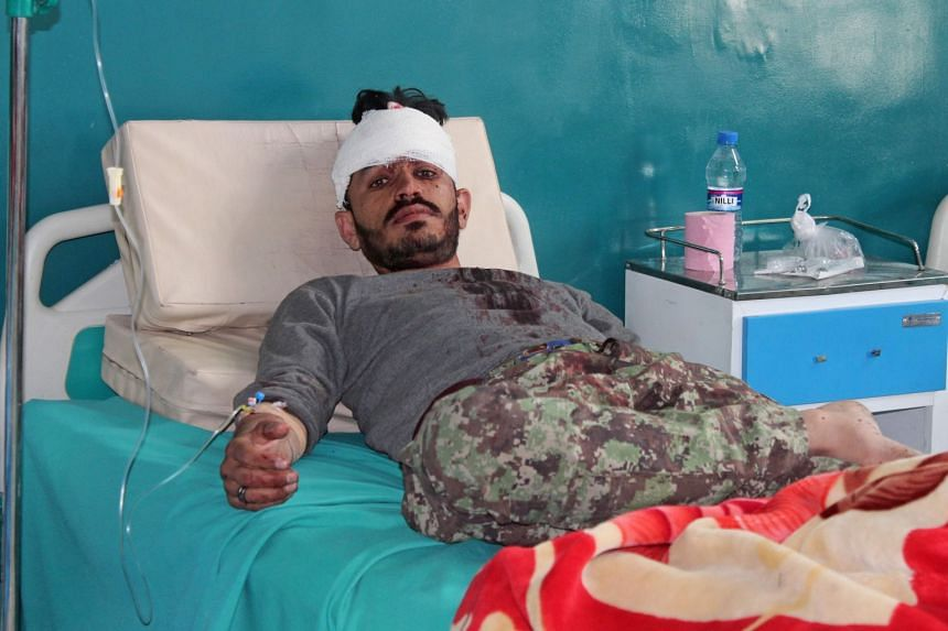 A wounded Afghan National Army soldier rests at a hospital after an attack on Afghan army base in Gardez, capital of Paktia province on May 14, 2020.