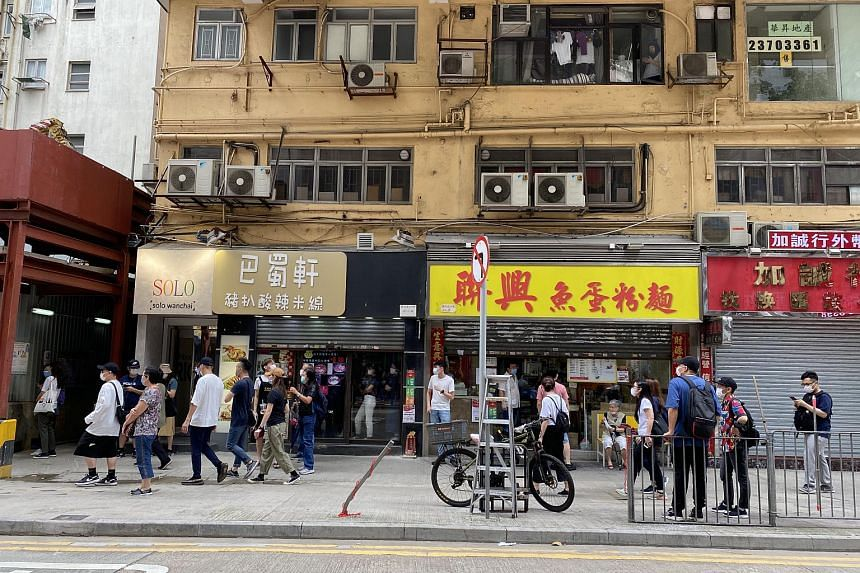Shops along Marsh Road in Wan Chai drawing their shutters as tension builds in Hong Kong, on May 24, 2020.