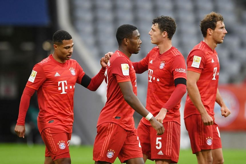 Bayern's Serge Gnabry (left) and Benjamin Pavard celebrate their fifth goal.