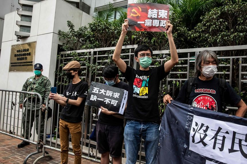 Pro-democracy activists protest against a proposed new security law outside the Chinese Liaison Office in Hong Kong on May 24, 2020.