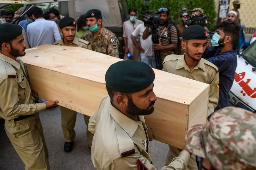 Army troops carry the coffin of a victim during a funeral the day after the crash.