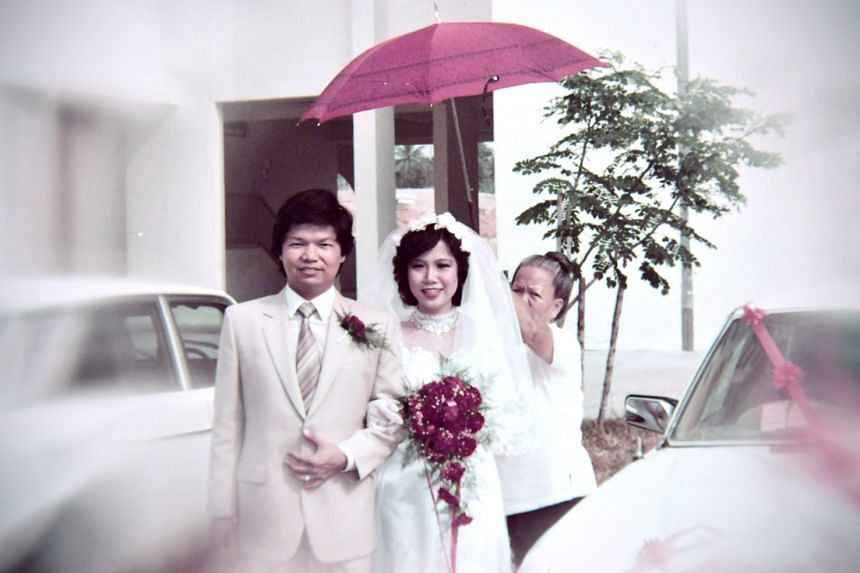 Steven and Lai Quen on their wedding day on March 24, 1983. The couple have three daughters.
